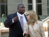(Lt. to Rt.) Cedric Augustine 38 of Long Beach, California and his lawyer Virginia Grady leave the...