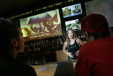 Bartender Christy Zollar, 32, of Denver, (center) discusses the similarities between the O.J....