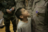 Emilio Escoto, 8, from California, looks up at his dad, SPC Johnny Escoto, Bravo Battery, 5-5 Air...