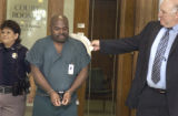 Gerald Brown (cq) gets a slap on the back from his attorney  Michael Root as he left Denver County...