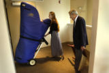 Harpist, Mia Crager (cq right),18,  and her father, Dick Crager (cq left) load Mia's harp into a...
