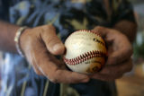 Ivan Majestic of Franktown holds a baseball given to him nearly five years ago by his dead son,...