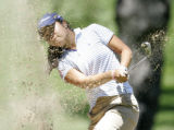 Esther Choe chips out of a bunker on the third hole of the second round as she qualifies for the...