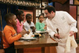 NEW YORK April 14, 2005 - Renowned chef Emeril Lagasse asks Camarri Haythe, age 8, how the...