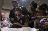 Melissa Martinez(cq), front middle, mother of Krystal Dawn Martinez(cq), in casket, cries with...