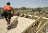 Carpenter Joel Hernandez (cq) works on a new home in the Timber Ridge subdivision in Severence ,...