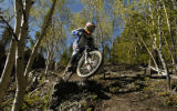 Matt Thompson (cq) charges down a trail Monday afternoon June 13, 2005 near Breckenridge while...