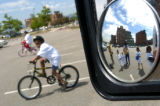 Eight-year-old Jared Barber (cq), directly left of mirror, and 11-year-old Alexandra Meallet (cq),...