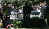 At Mount Olivet Cemetery in Wheatridge, the caskets of  Javad Marshall Fields (r) and Vivian Wolfe...
