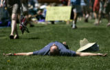 Jon Schnell (cq), of Denver, lays down and ctaches some sun at the 32nd Annual Telluride Bluegrass...