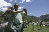 Jessica Pope (cq), left, of Flagstaff, AZ, dances with friend Dave Andrews (cq), right, of...