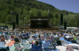 Festival-goers watch Ike Sheldon of The Wilders perform at the 32nd Annual Telluride Bluegrass...