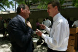 Denver Public Schools superintendent Jerry Wartgow, left, talks with Michael Bennet after Bennet...