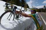 (GOLDEN, Colo., May 10, 2005) Tyler Hamilton removes his bike out of the snow on Squaw Pass after...