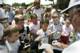 Golf performer Dennis Walters signs autographs and instipres youngsters after performing in The...