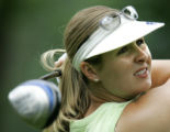 Hillary Lunke, winner of the 2003 U.S. Womens Open tees off on the fifth hole during a practice...