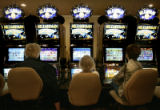 L-R Marilyn Morehouse (cq) Gerry Cassuto (cq) and Jeanne Mindham (cq) play the slots at Scarlet's,...