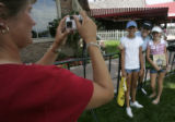 Andrea Smejkal (cq), left, of Nebraska, takes a picture of her daughter, Morgan Smejkal (cq), 12,...