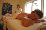 (BOULDER, Colo., May 5, 2005) Masseuse Holly Beggs, cyclist Tyler Hamliton as he receives sports...