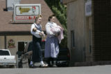 Women carrying babies walk into the local grocery story in the polygamist community in Hildale,...