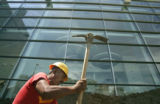 Construction worker Antonio Hernandez digs  outside the Colorado Convention Center on Monday, June...