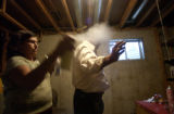 "(Lt. to Rt.) Faith Healer ""Curandera"" Maria Contreras (CQ), 46,performs a cleansing on..."