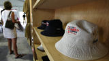A 'bucket hat' sits on a shelf at a merchandise pavillion at the 2005 U.S. Women's Open at Cherry...