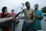 Corey Rice (CQ), 27, center, of Kansas City, Missouri, explains how he rendered aid to a woman he...