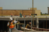 Construction workers continue to work on Twenty Ninth Street project in Boulder Tuesday morning...