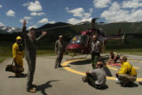 Ken Host, (cq) left, pilot of Dept. of Energy's helicopter, talks to Rocky Mountain National park...