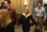 A victim  (center) of Brent J. Brents leaves Denver County court after Brents pleaded guilty to 66...