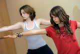 Sydney Morauer (cq, right), 15 and Katy Ansbaugh (cq, left), 16, both of Boulder, practice yoga at...