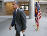 Denver District Attorney Mitch Morrissey  leaves a press conference after announcing that his...