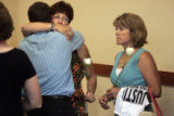 Todd Stansfield, cq, left, hugs Mary Majestic, cq, mother of Tony Majestic, after a court...