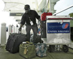 Denver, CO July 26, 2005 Kofi(cq) Arthur, a 67-year-old baggage handler for United Airlines, loads...