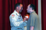 (COLORADO SPRINGS, CO. JUNE 4, 2004) (lt. to rt.) Lt. Col. Nat Sassaman, pins a Purple Heart on...