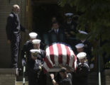 The casket containing the body of Navy Seal Danny Phillip Dietz  is carried down steps to be...