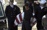 The casket containing the body of Navy Seal Danny Phillip Dietz  is placed in a hearse by Navy...