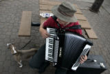 Dave Morton, Boulder, plays the accordian for members of the group Alliance Francaise de Denver,...