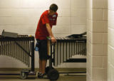 David Bearss(cq), a ninth grader from Littleton High School, waits to pull a xylophone into the...