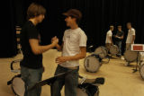 Justin Weber(cq), left, a sophomore at Dakota Ridge High School shakes hands with Bryan...