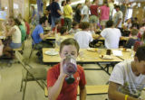 Granby, CO July 29, 2005 Prescott Delaware, 11, of Louisvilled eats and drinks in the cafeteria at...