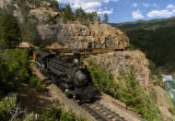 A Durango & Silverton Narrow Gauge Railroad train makes its way above the Animas River toward...