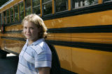 Brooke Mattson, 10, 5th grade stands in front of a school bus at her school, Wyman Elementary. ...