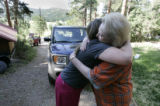 Kimbre (cq) Coronado (left) hugs her mom Julianne Hart after returning to Hart's home in  Beulah,...