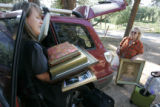 Kimbre (cq) Coronado (left) helps her  her mom Julianne Hart unpack valuables after returning to...