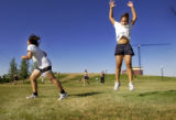 Justina Chao (cq) 16, right, finishes her jumping jacks as her mother, Mouy Sanchez (cq) 36,...
