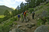Scott Esser (cq),Eric Bratrud (cq) and Mark Thomas (cq), left to right, head up the trail head for...