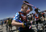 Colin Connors (cq), left, 17, gputs on his medal after finishing the Courage Classic, a three-day,...