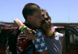 Colin Connors (cq), left, 17, gets a hug from his mother Yvonne Grinnell (cq), both of Denver,...